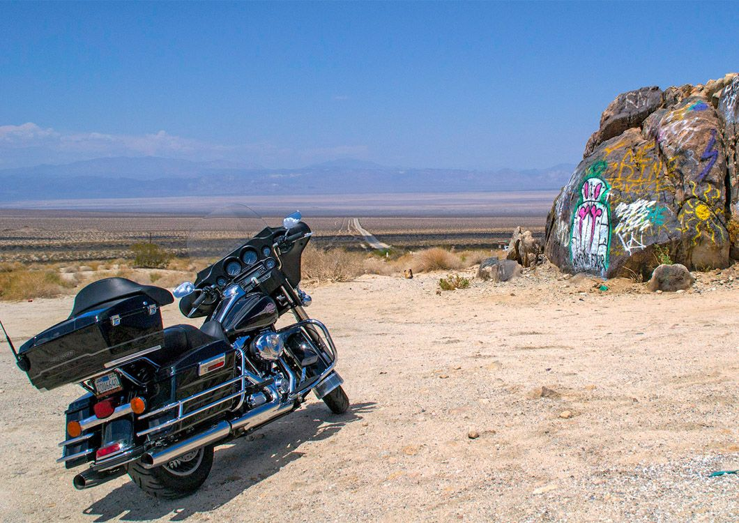 Harley Davidson, painted rocks on the background
