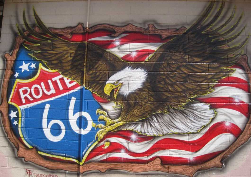 route 66 sign with american flag and bald eagle