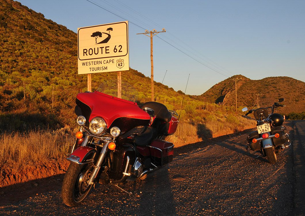 harley davidson motorcycles in front of a route 62 sign south africa