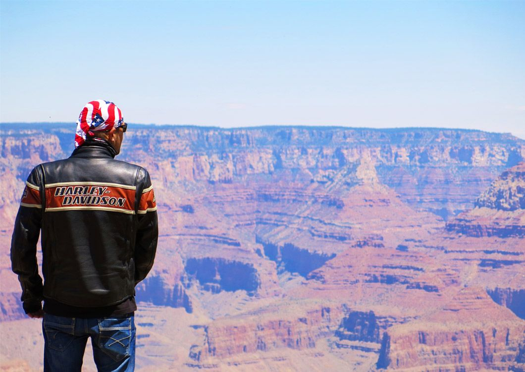 Harley davidson rider contemplating the great canyon
